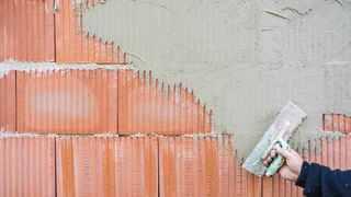 Aubauhaus Eigenleistung Außenputz auftragen