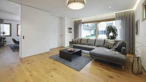 Wohnzimmer im Musterhaus CityLife 600 von WeberHaus
