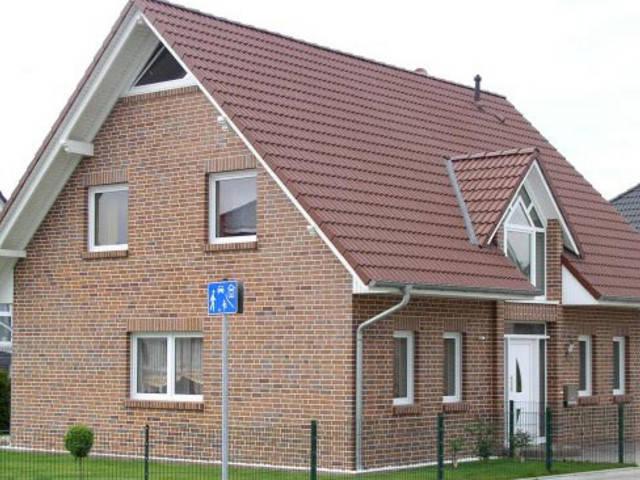Massivhaus mit Satteldach von Euro Massiv Bau