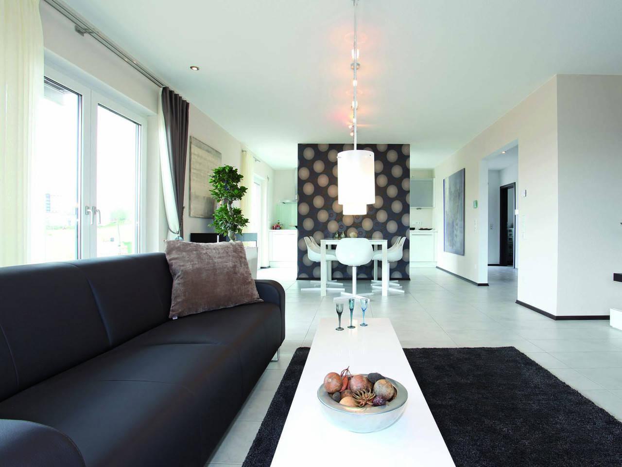Wohnzimmer MEDLEY 300 als Stadtvilla von FingerHaus