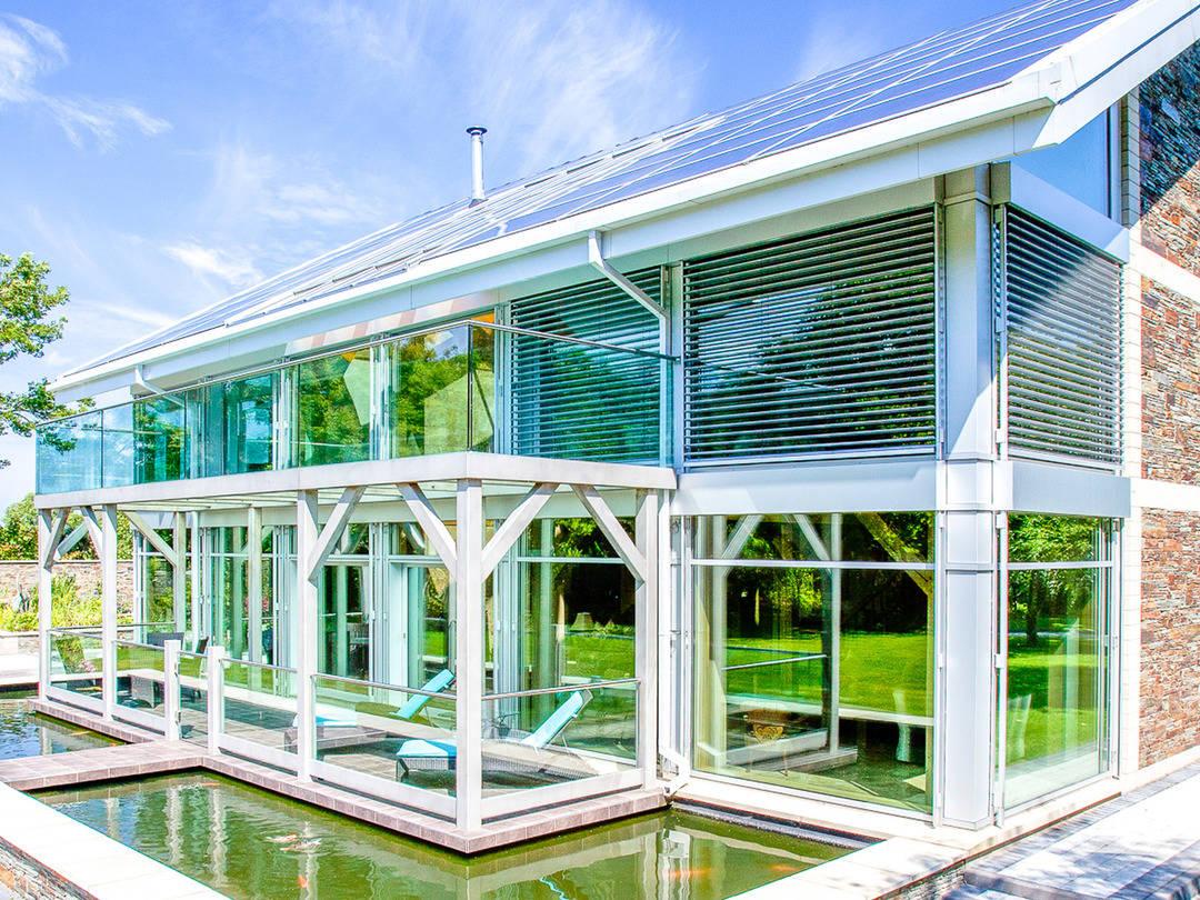Aussenansicht Haus Isle of Man Teichansicht von Holzbau Becker & Sohn
