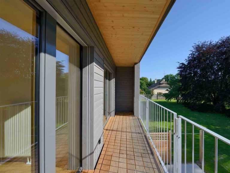 Mehrfamilienhaus Gardet - Baufritz Terrasse