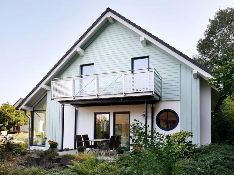 Musterhaus Creatione UNO M Gartenansicht von Partner-Haus