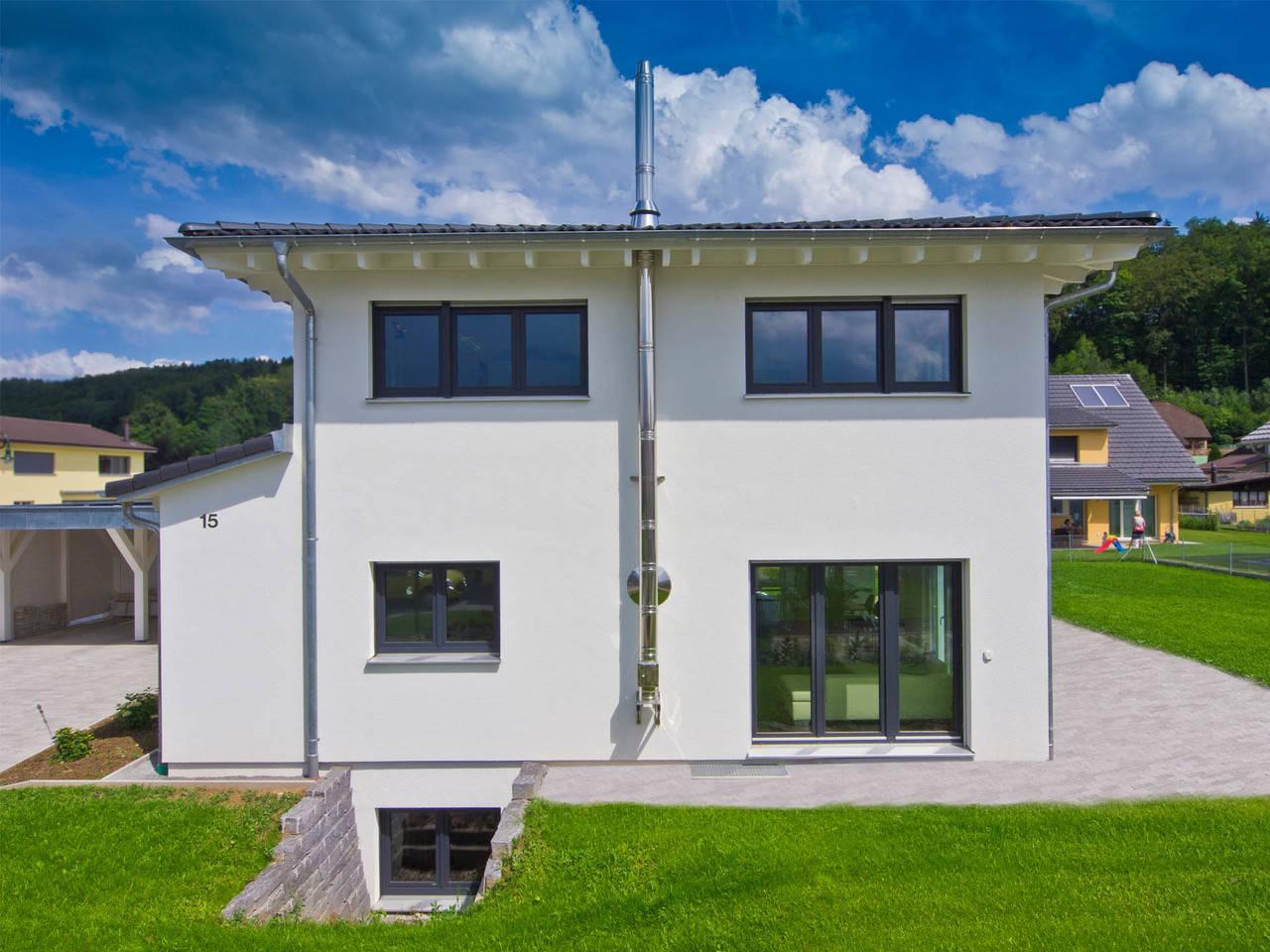 Fertighaus Weiss Stadtvilla Studer Seitenansicht