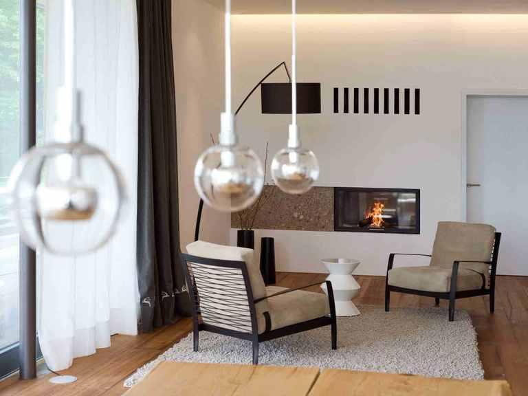 Designhaus Weitblick - Baufritz Ruhezone mit Kamin