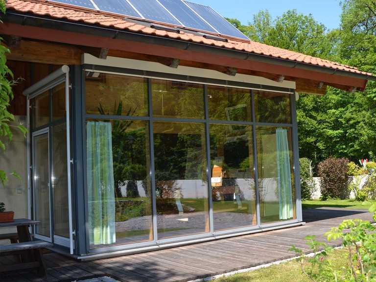 Massiv-Holzhaus Seiboldsdorf Fensterfront