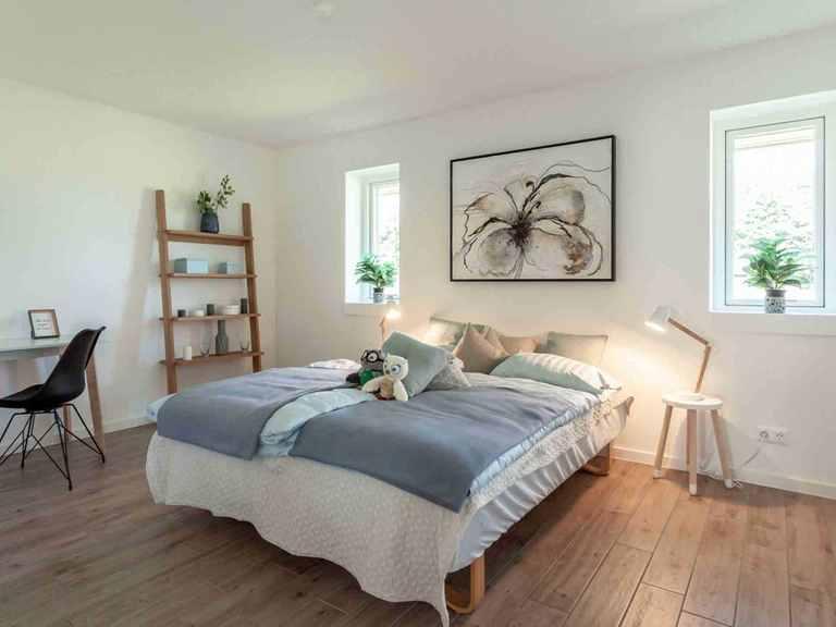 Bungalow B110 - Die HausCompagnie Schlafzimmer