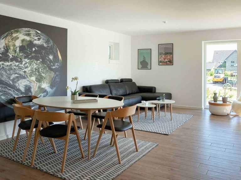 Bungalow B131 - Die HausCompagnie Wohn- und Essbereich
