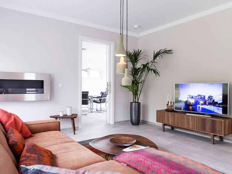 Wohnzimmer - Musterhaus Schkeuditz von OKAL Haus