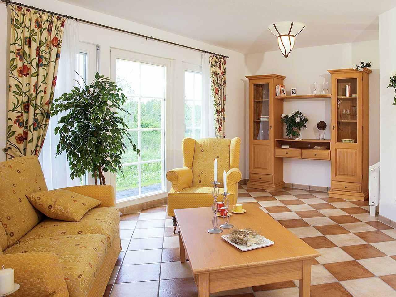 Wohnzimmer - Musterhaus Erfurt von OKAL Haus