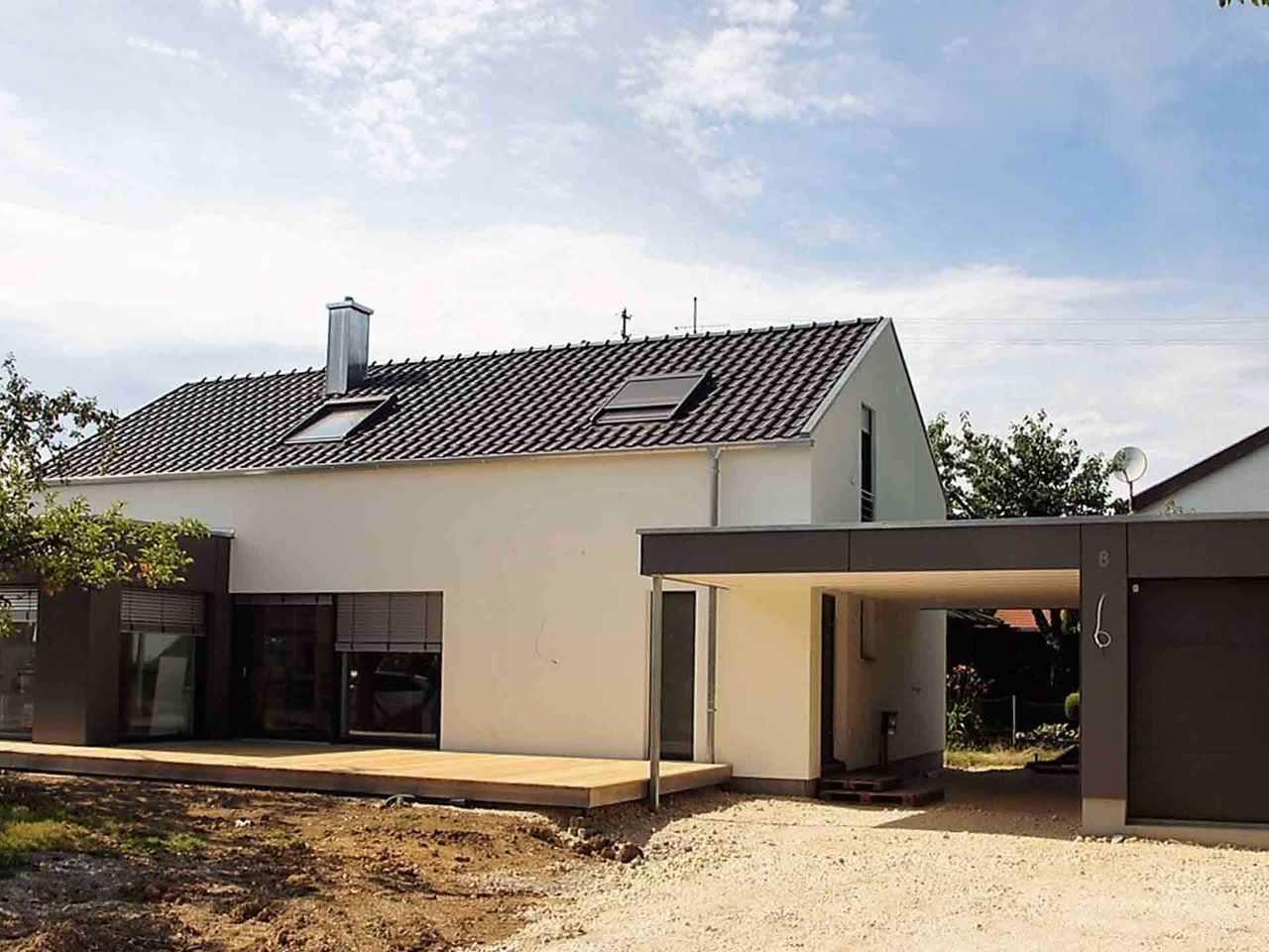 Kundenhaus mit Flachdachanbau - Holzbau Kielwein