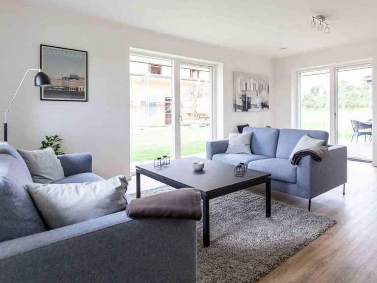 Musterhaus H-Bungalow Schleswig - Die HausCompagnie Wohnzimmer