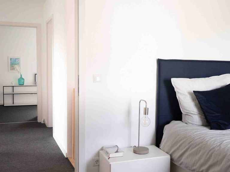 Stadtvilla Halstenbek - Die HausCompagnie Schlafzimmer der Eltern