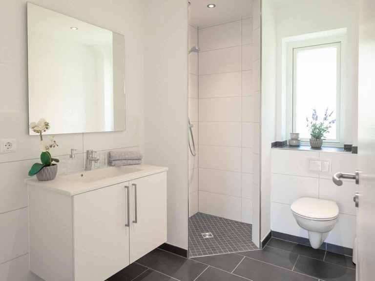 Winkelbungalow Hürup - Die HausCompagnie Badezimmer
