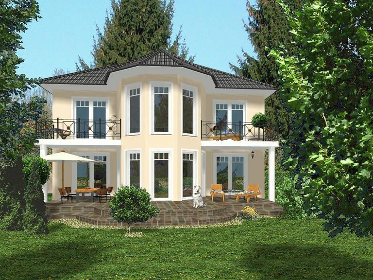 Aussenansicht auf die Hausrückseite mit Terrasse.