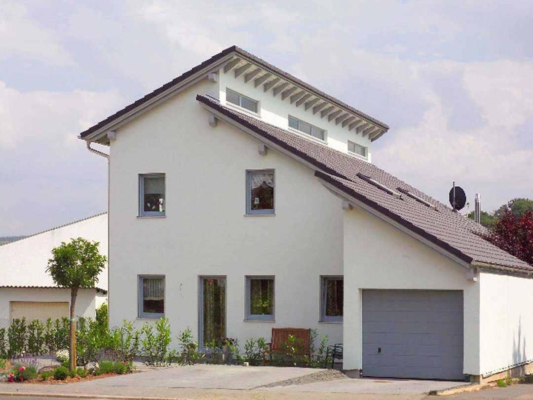 ▷ Einfamilienhaus mit Einliegerwohnung – WOLF System Haus