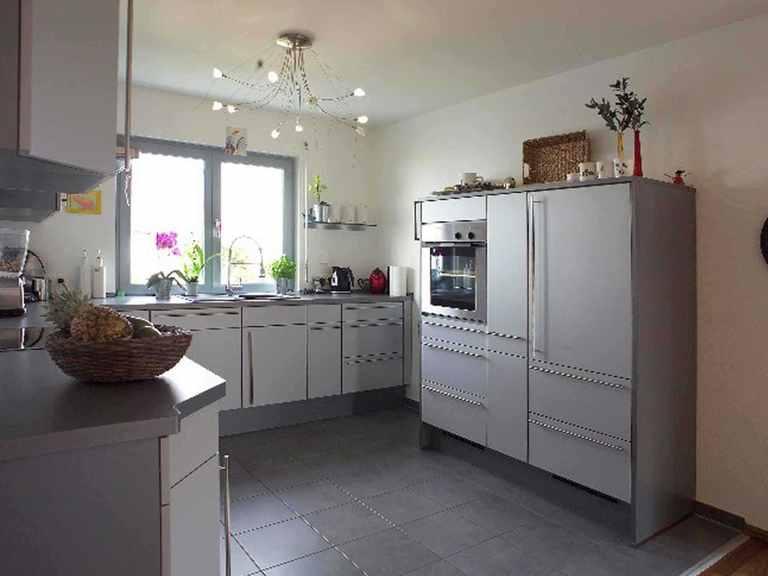 Einfamilienhaus mit Einliegerwohnung - WOLF System Haus Offene Küche