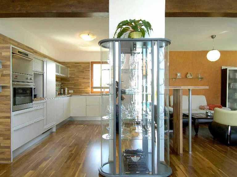 Individuell geplantes Kundenhaus 4 - WOLF System Haus Offene Küche und Wohnbereich